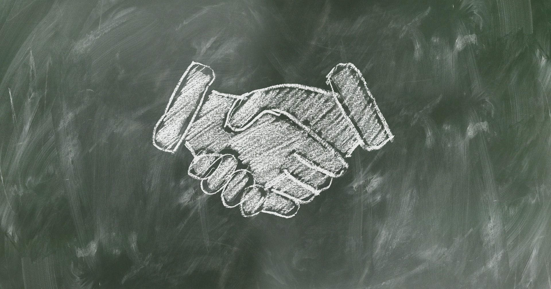 A chalk drawing of two shaking hands, representing customers and movers River Edge NJ.