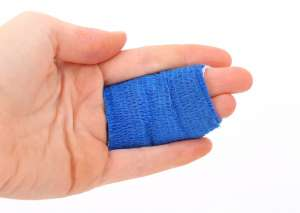 A person's fingers in band aid after not being able to avoid moving injuries.