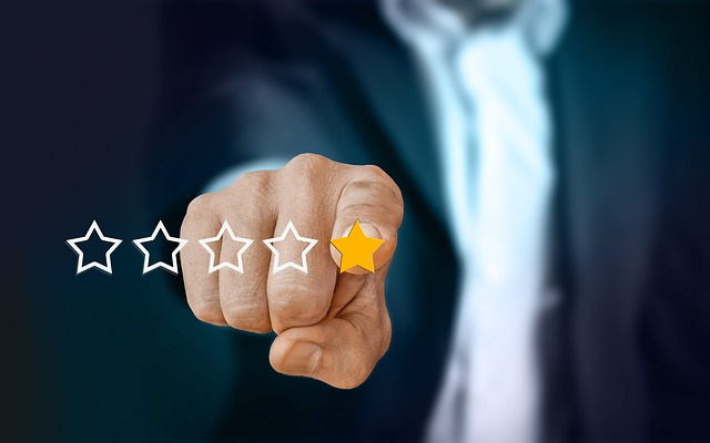 Man's hand pointing to a yellow star of five