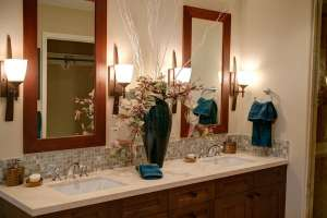 A double sink with two mirrors.