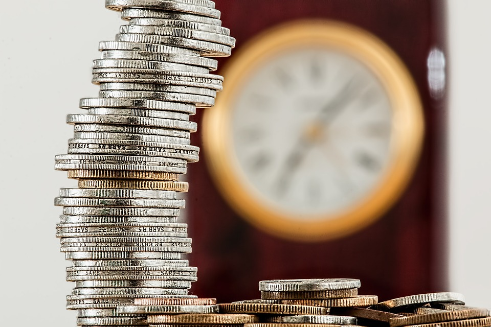 A clock and a pile of coins to pay for Asbury Park movers.