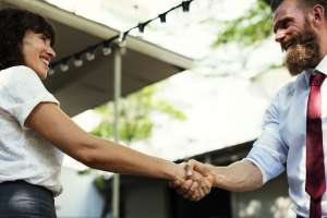 A handshake between a man and a woman.