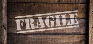 A wooden box with 'fragile' written on it