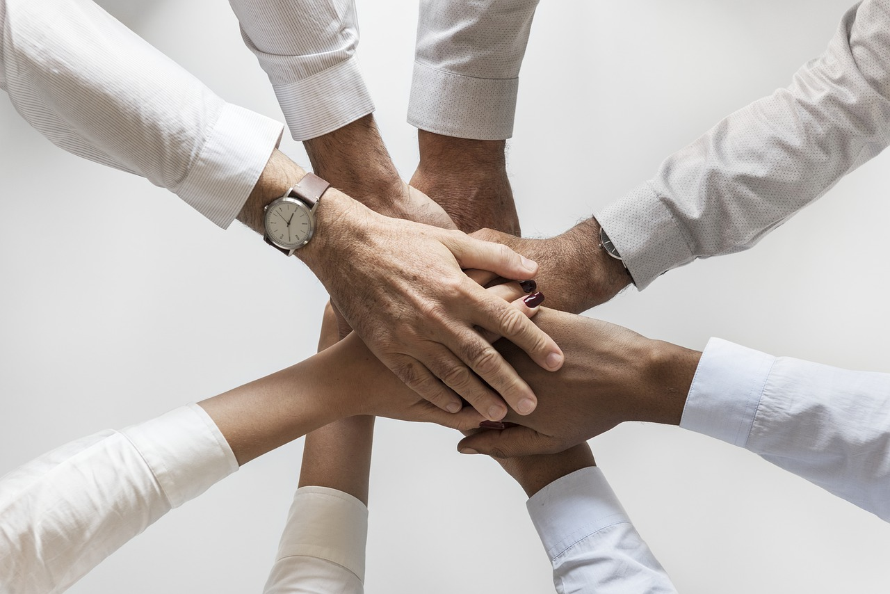 A team of people holding hands