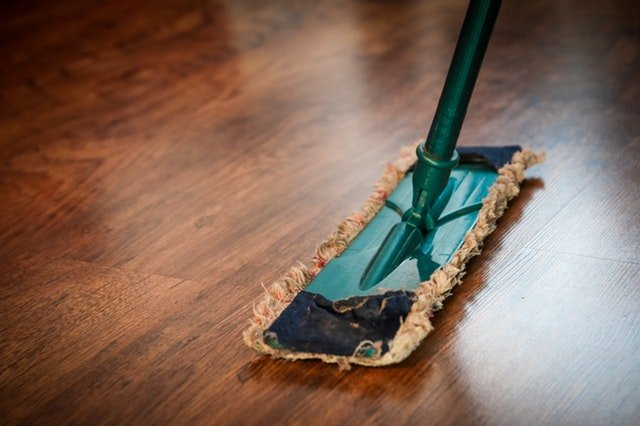 Mopping the brown wooden floor