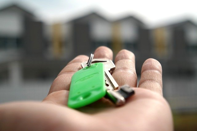 Man holding a key to the new home