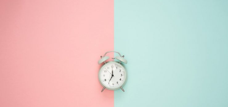 A clock on a pink and blue surface - Union Beach movers