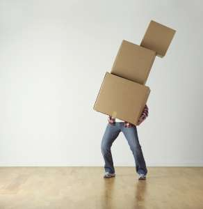 A person carrying cardboard boxes.