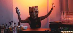 person wearing a mask while hoasting a housewarming party in Edison
