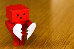 A moving box holding a broken heart