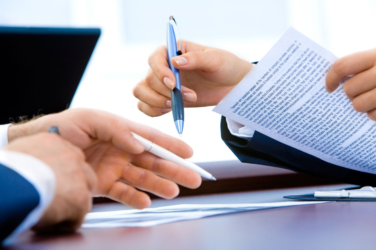 a person reviewing a contract in or der to handle disputes with movers