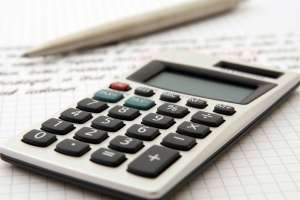 Swedesboro movers - a calculator, pen and a notebook