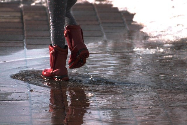 a person jumping into a puddle
