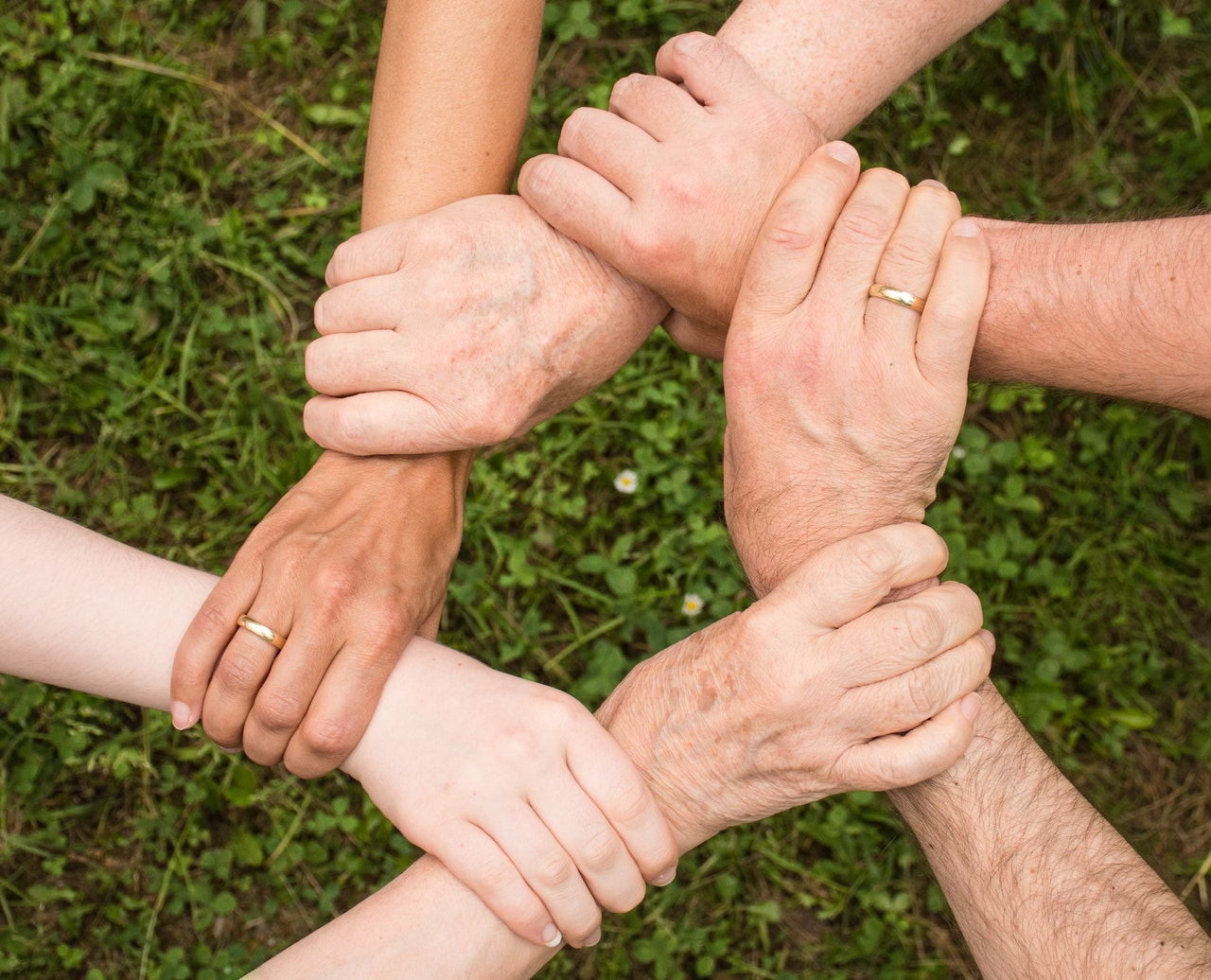 a picture of people holding hands
