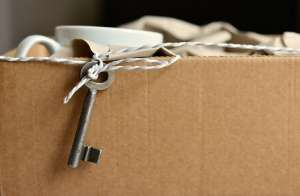 Spring Lake Movers - a cardboard box with a key