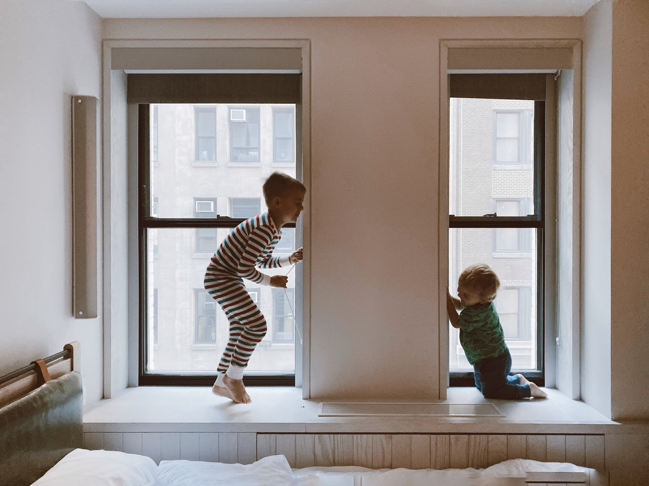 Two kids playing hide and seek
