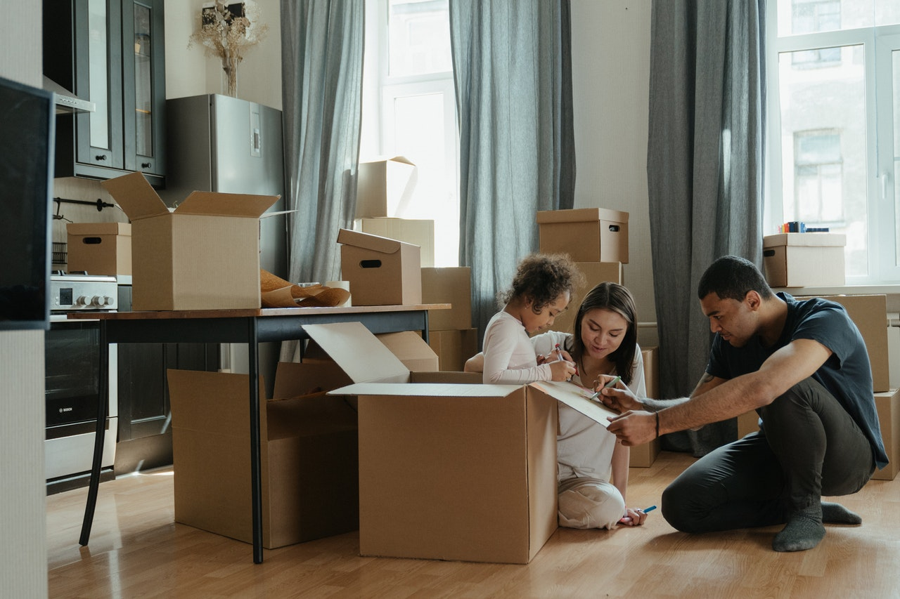 family unpacking after a move