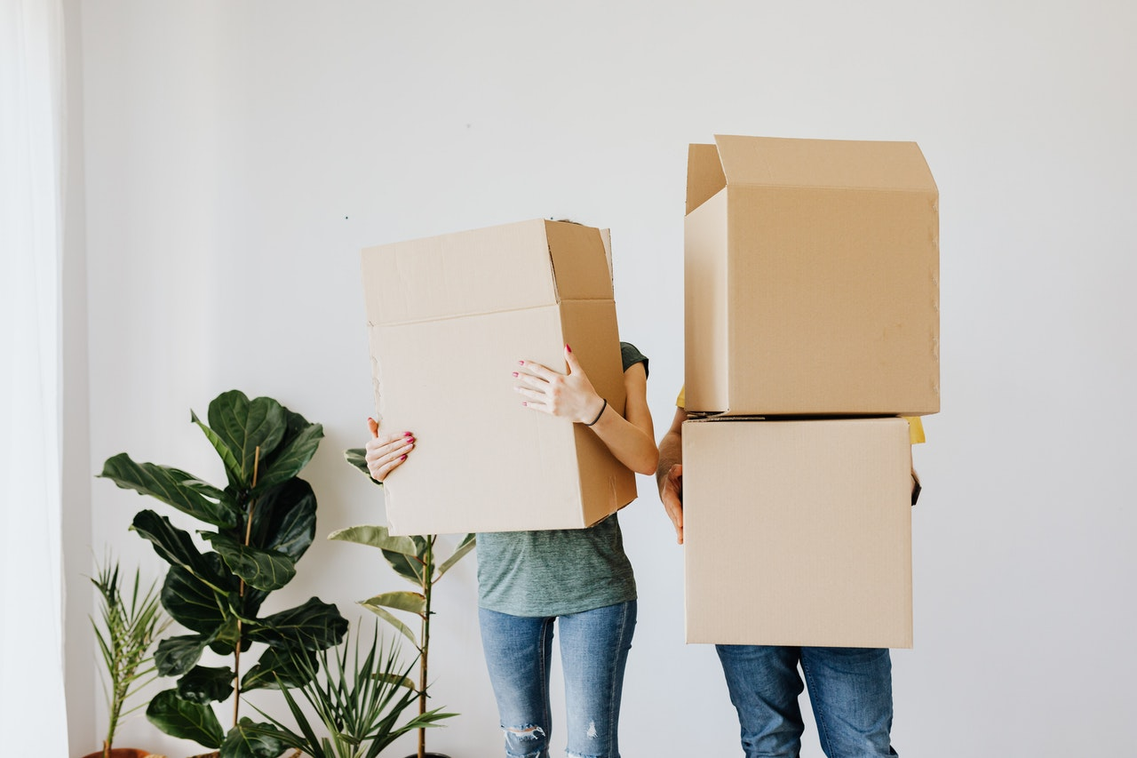 people holding cardboard boxes