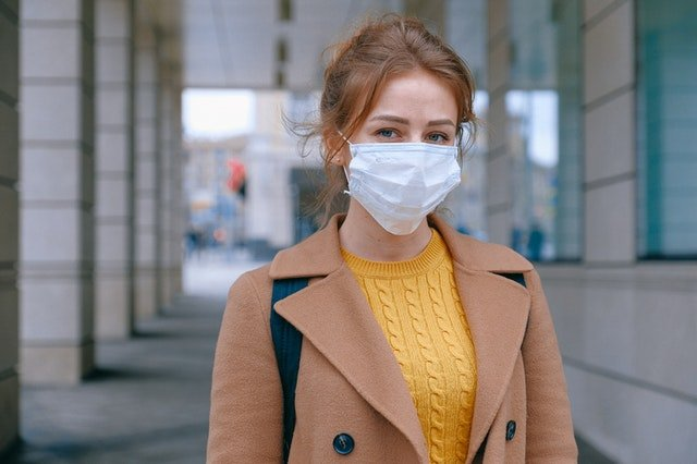 a woman with a mask moving to NJ during a pandemic