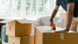 A man packing moving boxes