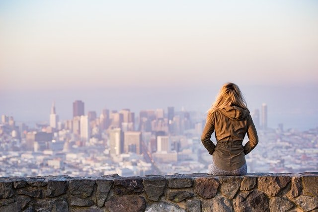 A woman staring at the city