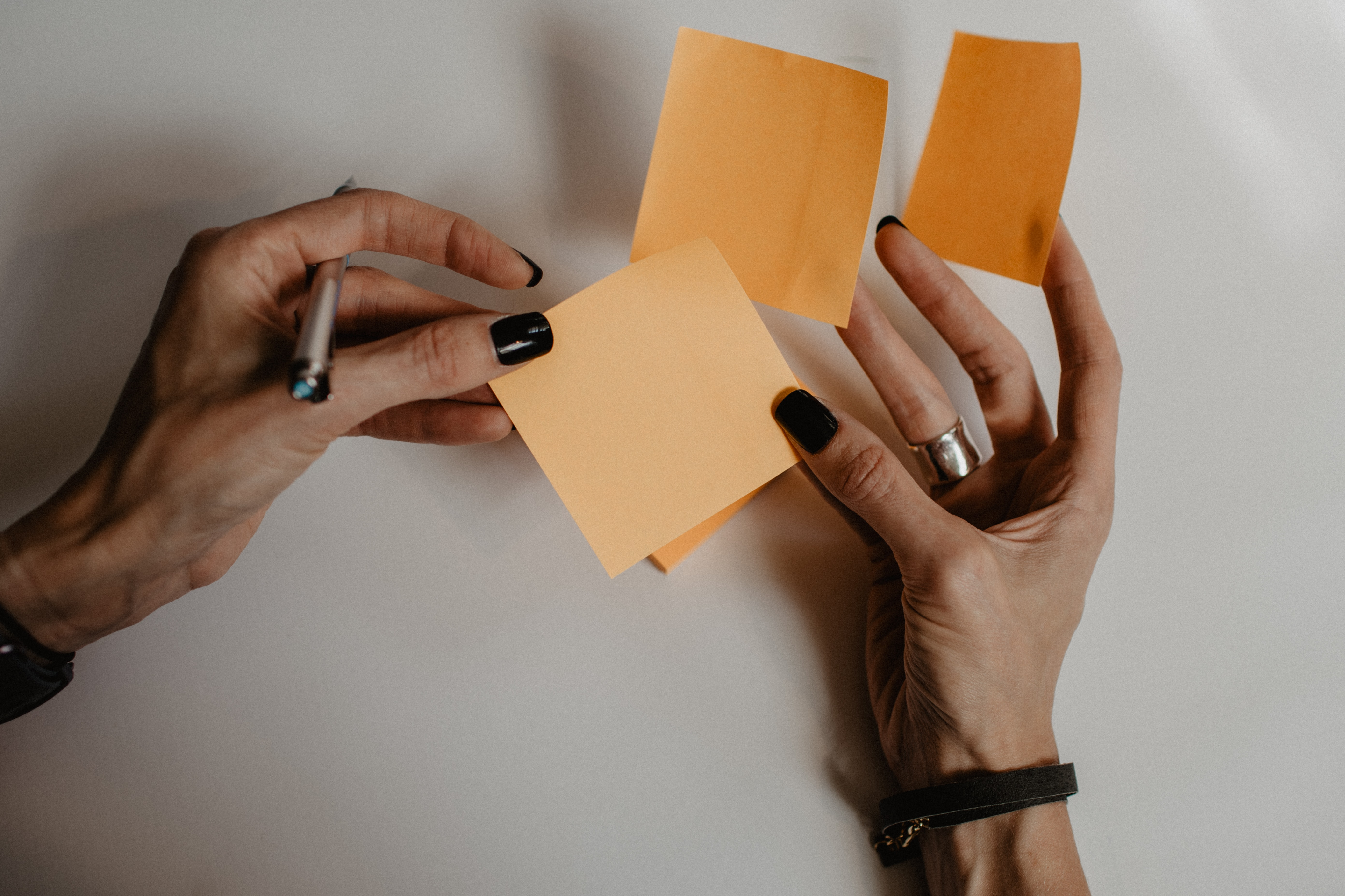 person holding sticky paper