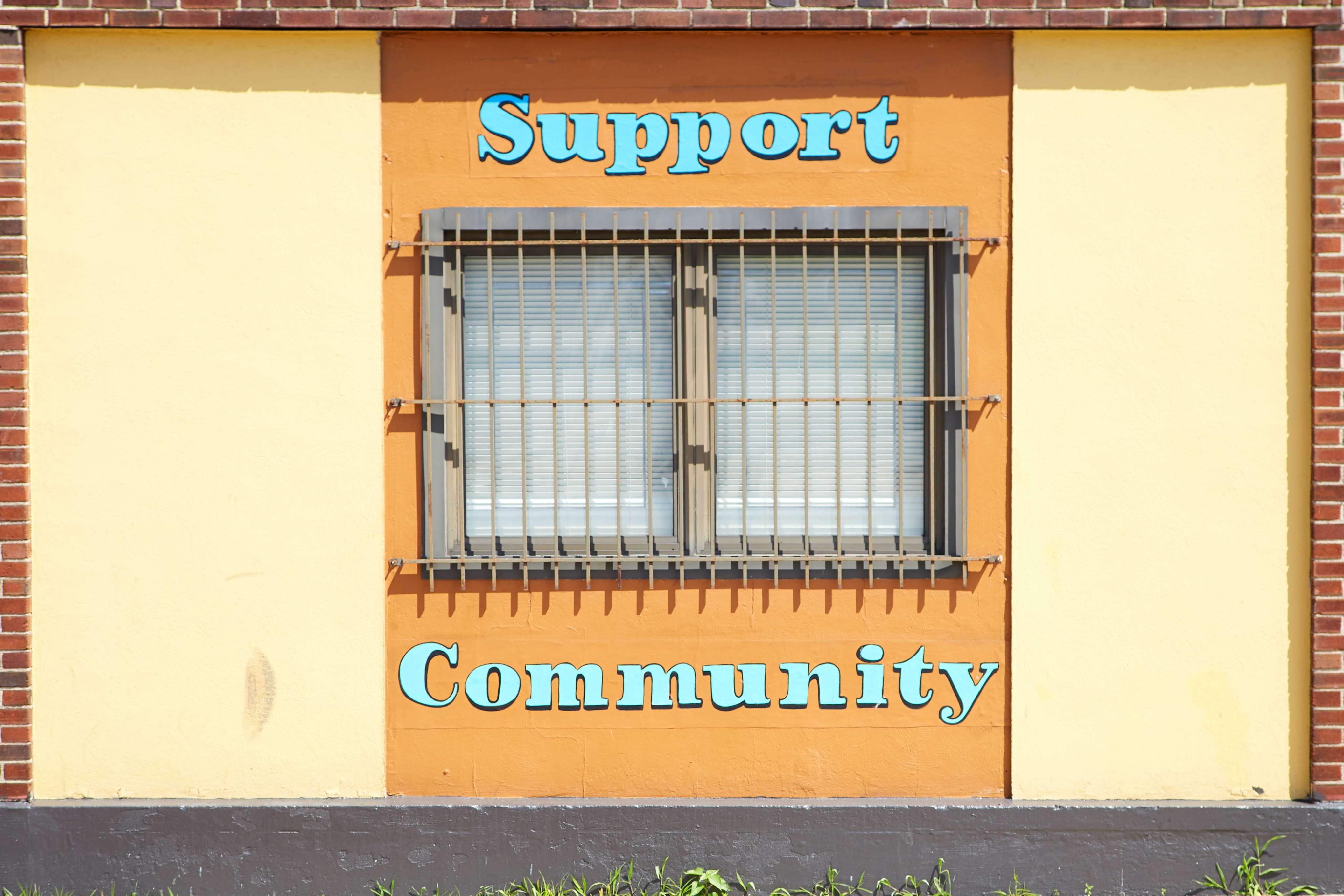 sign that says support community