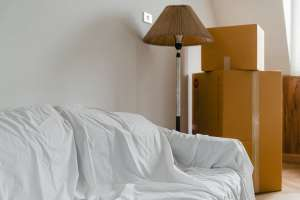 cardboard boxes a sofa and a lamp