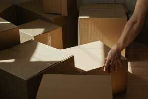 moving boxes and a hand