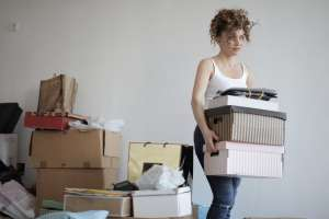 a woman decluttering to have a cost effective interstate relocation