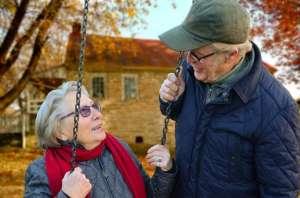 Two elders on a swing
