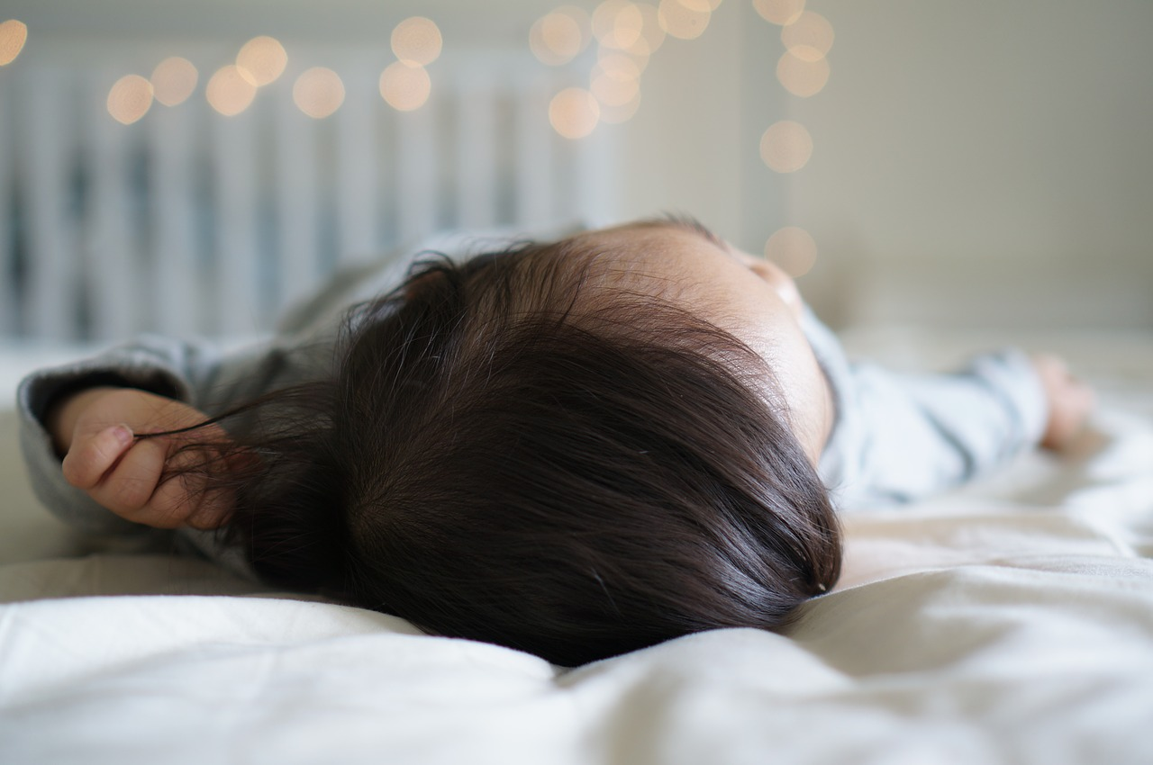 a baby sleeping in her room