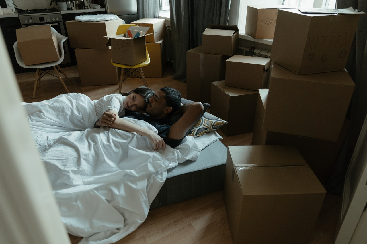 couple lying in an unpacked room