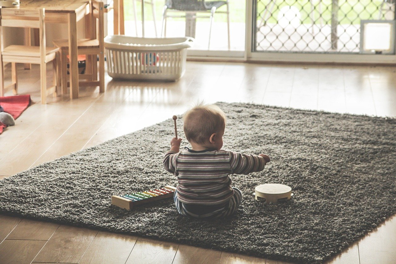 a child playing with toys on the carpet