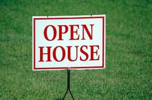 Open house sign on a lawn