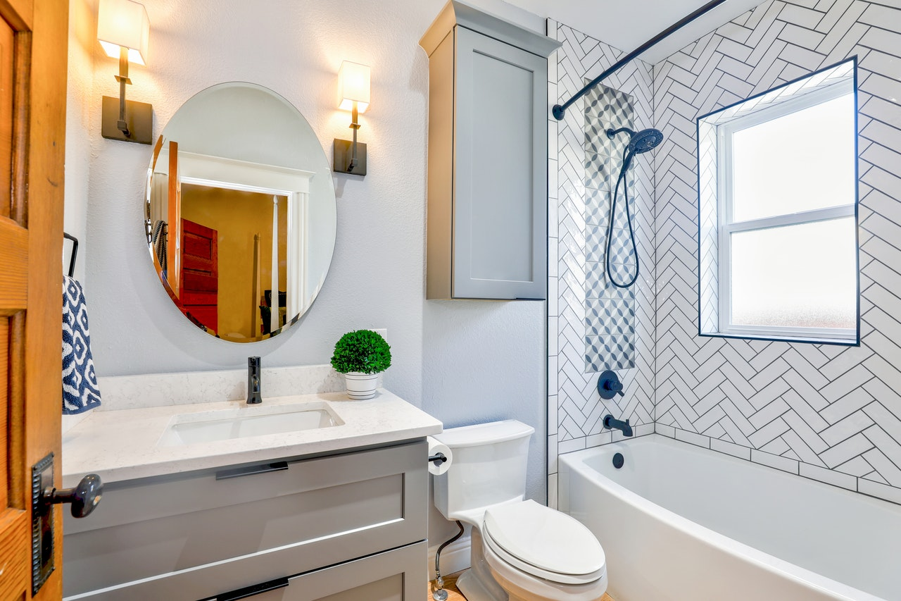 a large, oval mirror in the bathroom