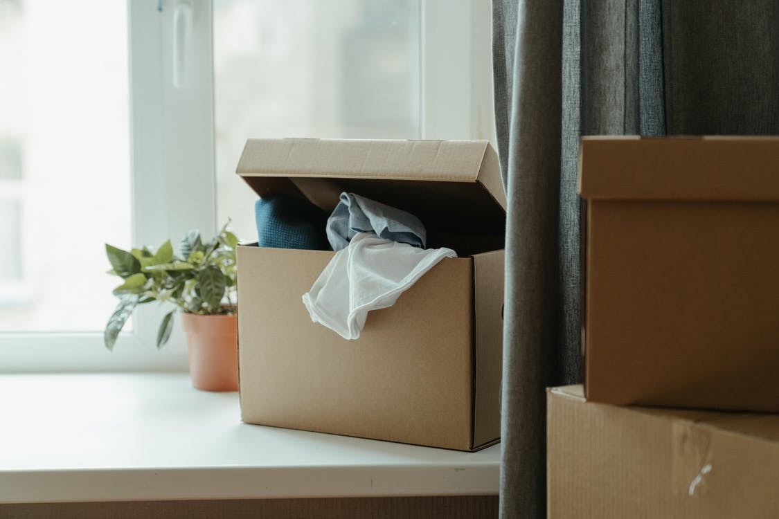 cardboard box with clothes