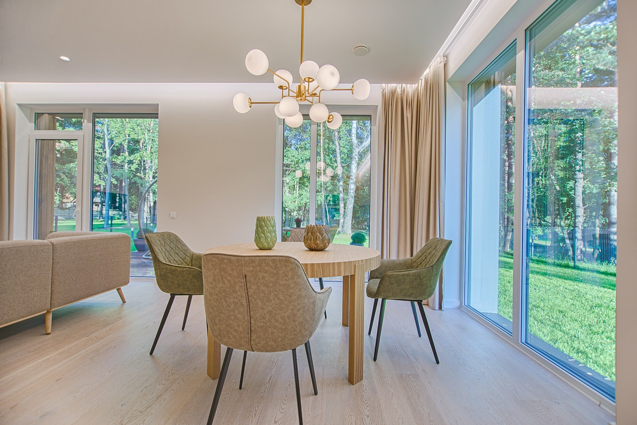 a dining table with chairs in a living room