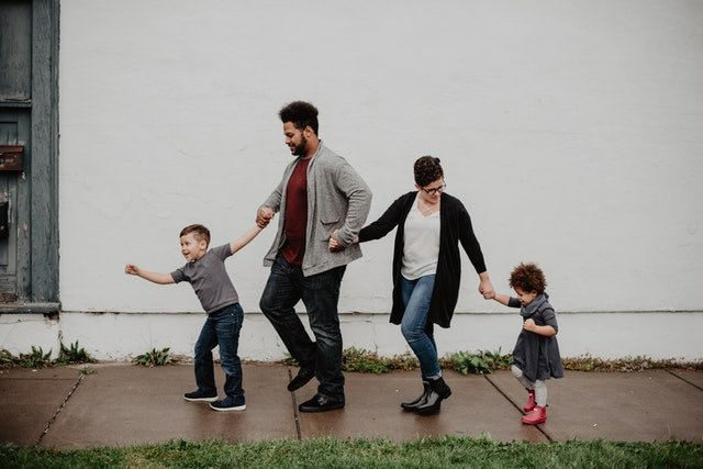 A whole family walking down the street