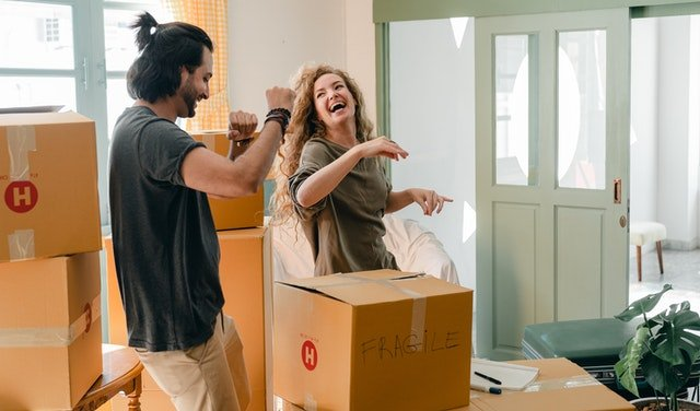 Two people packing and laughing