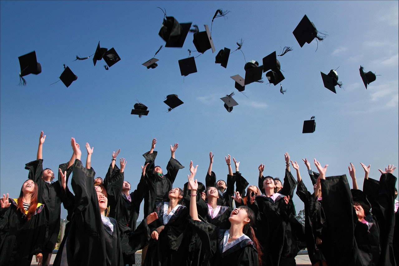 Students throwing graduation hats in the air