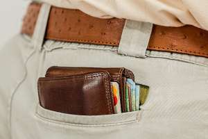 a wallet in a back pocket of a mans jeans