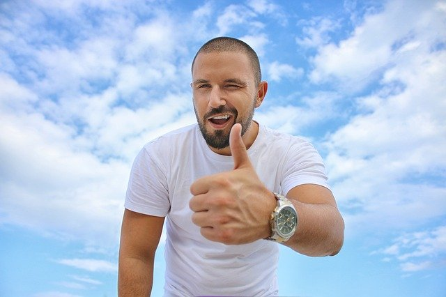 a man giving thumbs up