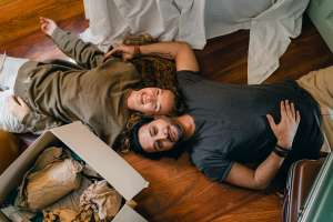couple laying on the floor