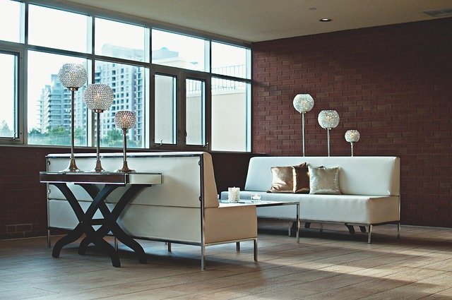 A room with two white sofas