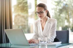 A corporate woman using laptop to organize moving your business to Toms River NJ
