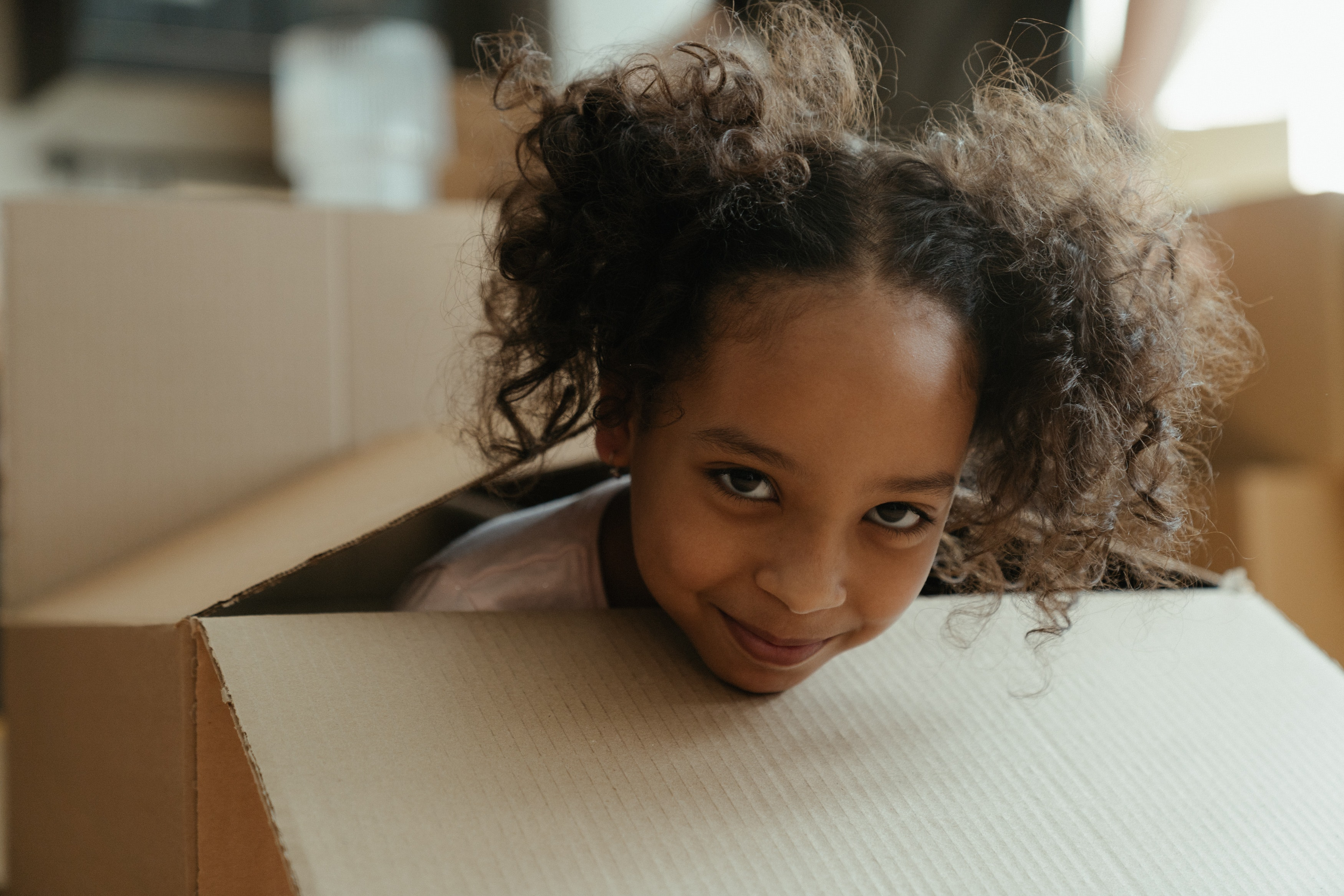 Kid is hiding in the box